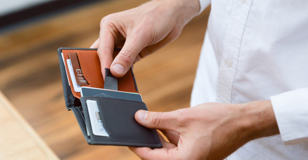 A Bellroy Note Sleeve Wallet in use